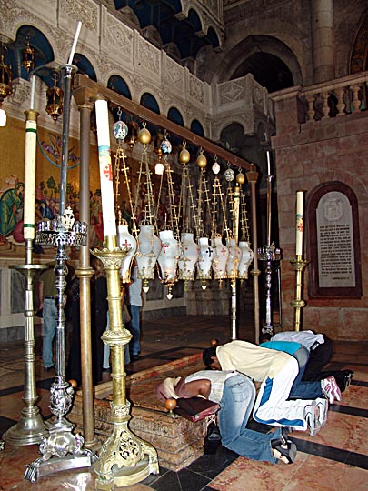 People praying by the Stone of the Anointing (Unction), at the Church of the Holy Sepulchre (the Church of the Resurrection), The Old City 2006