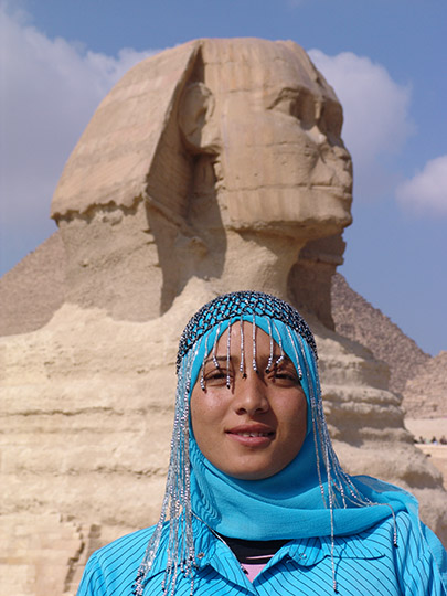 A local young Muslim woman wearing veil (Hijab) and the Great Sphinx of Giza, 2006