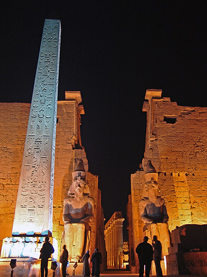 The Pylon of the Luxor Temple, with the two figures of Ramesses II along with an obelisk, illuminated at night, 2006
