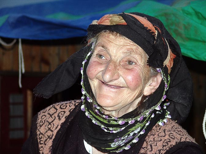 A smiling Turkish woman in Yukari Kavron, 2005