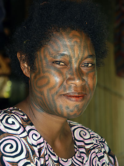 A woman with tattooed face, Kabuni Village 2009