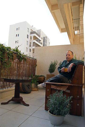 Jack Broner sips his tea on the balcony of his home, 2009