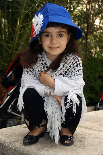 Arina from Iraqi Kurdistan enjoys a stroll in a garden, Jerusalem 2011